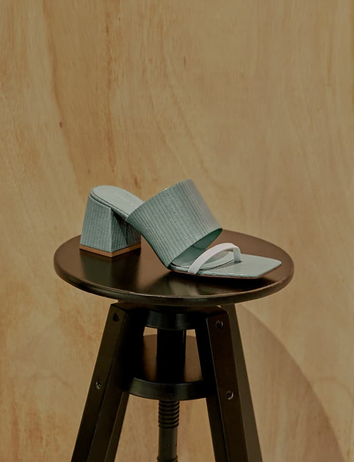 Women's snake print block heel mules in green (close up) – CHARLES & KEITH